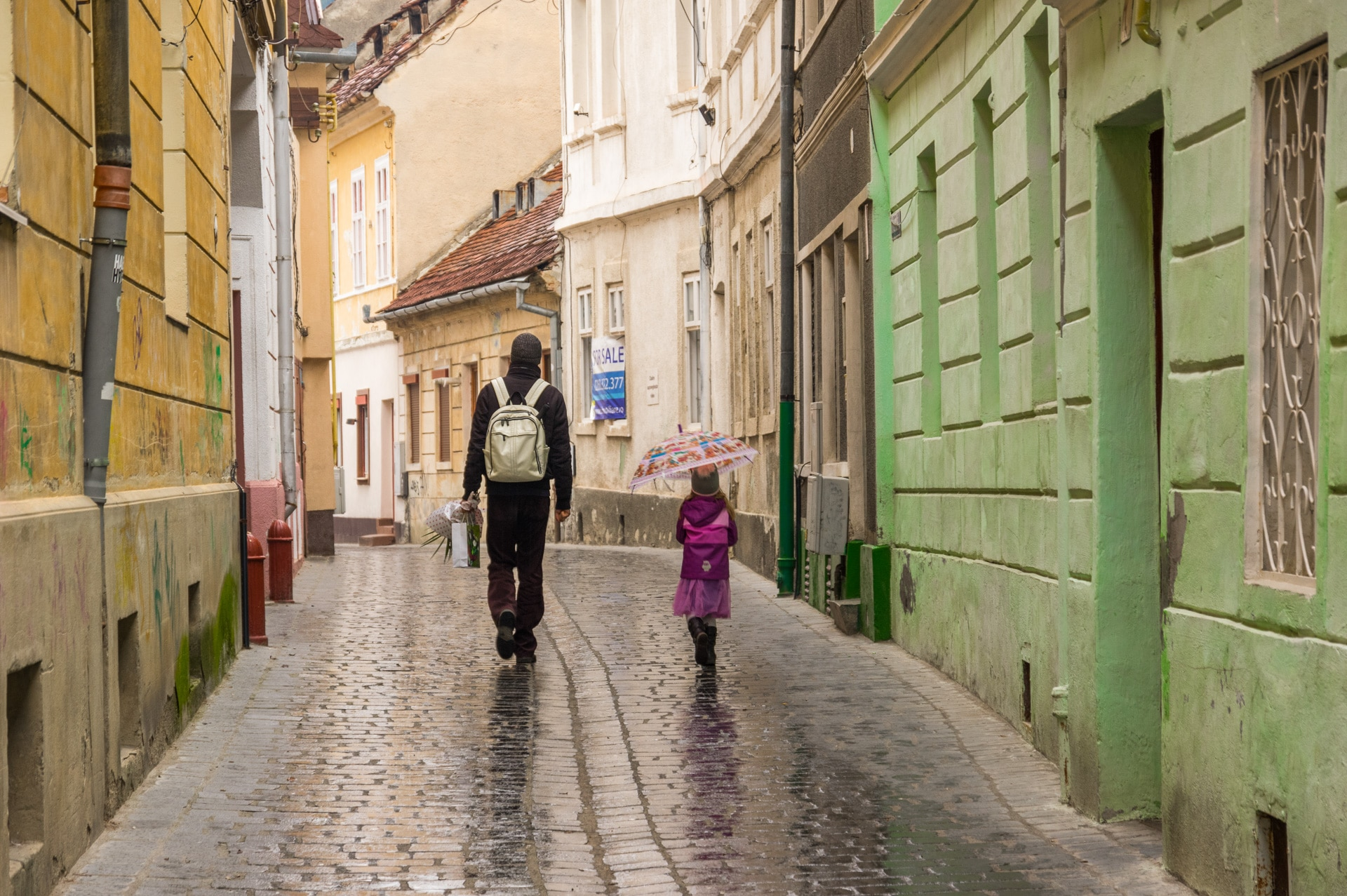 Father and girl on the streets of Brasov